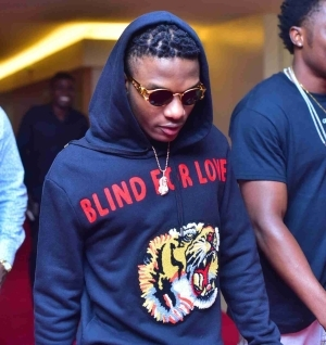 See How Singer Wizkid Reacts To Slave Trade In Libya (Photo)